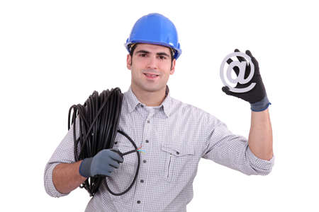 Electrician holding at sign photo
