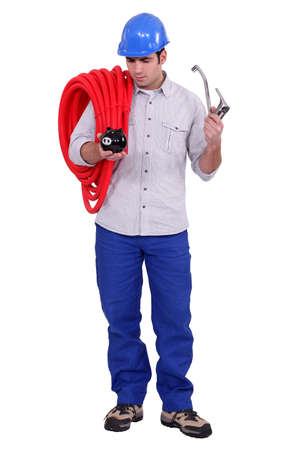 seep: Plumber holding piggy-bank and tap