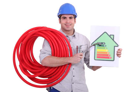 plumber holding a faucet and an energy consumption label photo