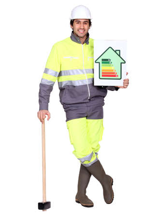 craftsman holding an energy consumption label Stock Photo - 17295177