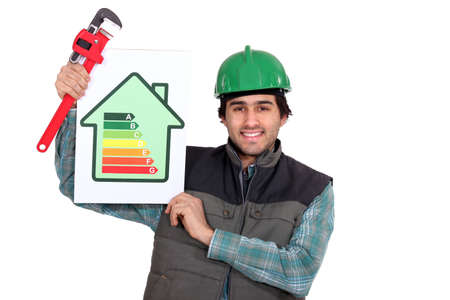 Tradesman holding a pipe wrench and an energy efficiency rating sign photo