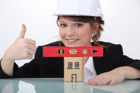 Engineer approving the use of a spirit level Stock Photo - 17297400