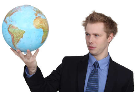 Man holding globe photo