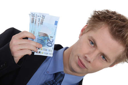 Landscape picture of young man with money photo