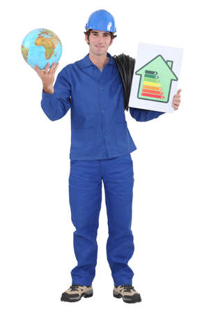 electrician holding globe and extension cord photo
