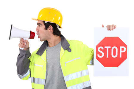 bawl: Man with megaphone holding stop sign