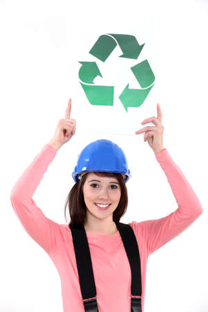 galvanize: Female construction worker holding a recycle sign