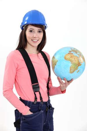 destruct: craftswoman holding a globe