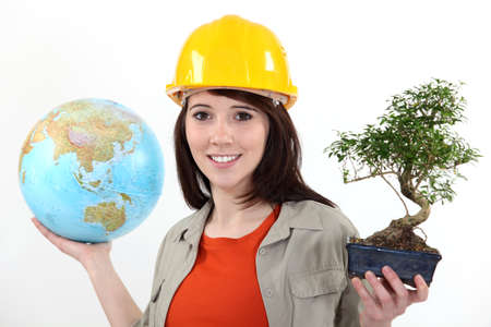 foreign: Worker planting trees abroad Stock Photo
