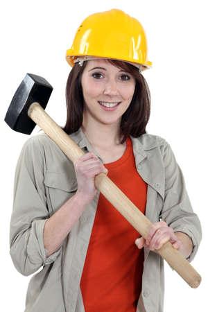 servicewoman: Female labouror holding  hammer