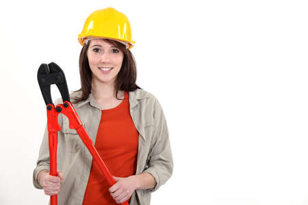 Female construction worker with boltcutters photo