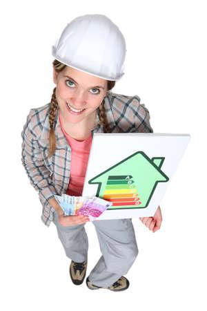 tradeswoman: Tradeswoman holding wad of money