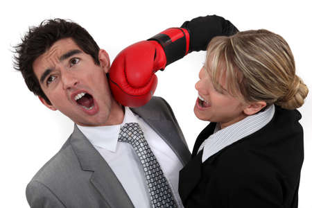 businessman and businesswoman boxing photo