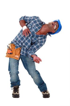delirious: Injured tradesman hallucinating Stock Photo