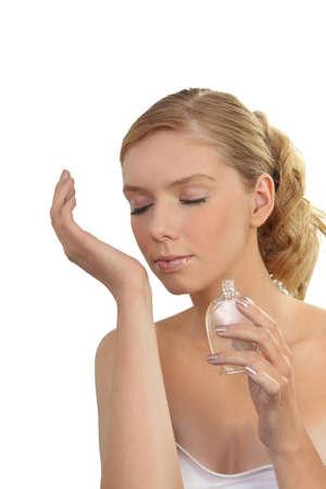 perfume woman: woman smelling a perfume