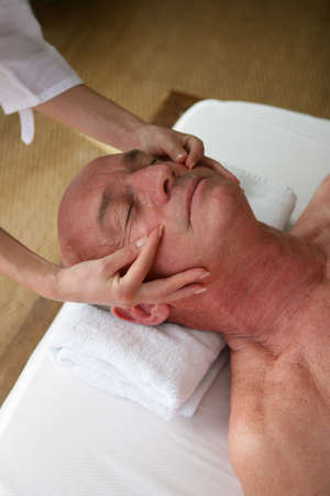 therapeutic: Senior man receiving head-massage