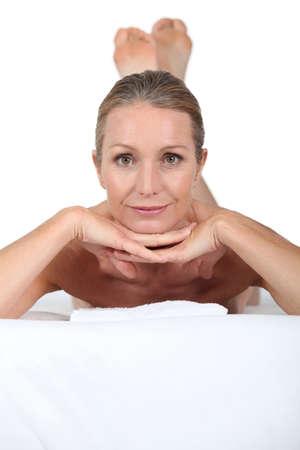 tiedup: Blond woman laid on massage table Stock Photo
