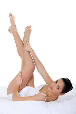 hair problem: Young woman touching her smooth legs