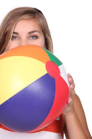 beach ball girl: Woman with a beach ball