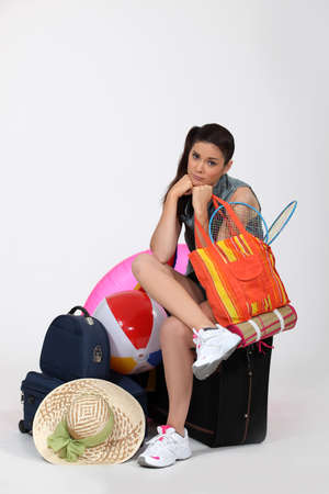 dismayed: Unhappy woman going away on vacation Stock Photo