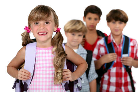 elementary age girl: kids wearing their school bags