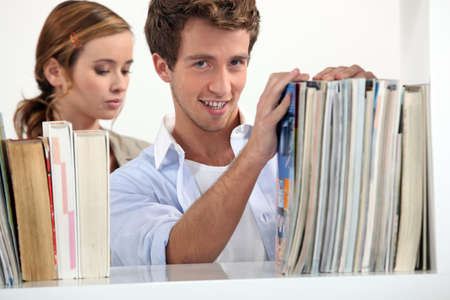 Young couple in the university library Stock Photo - 17304096