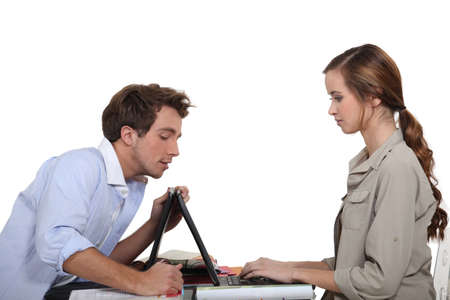 Man helping lady with laptop Stock Photo - 17295432