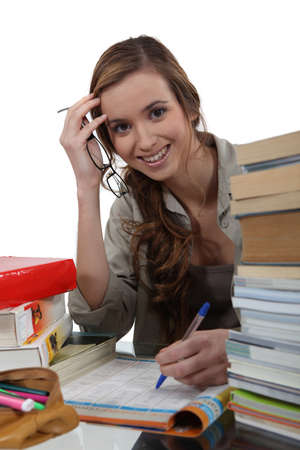 Smiling girl doing homework Stock Photo - 17298941