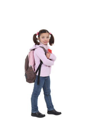 first day of school: Young girl going to school