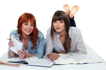 revising: Young women studying books