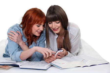 girl sit: two girls studying together