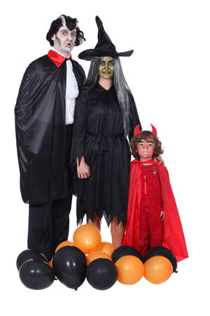 family celebrating Halloween photo