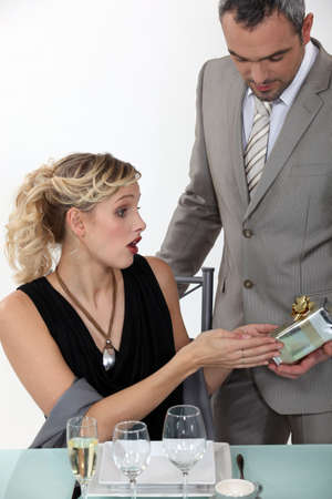 Surprised woman receiving a gift from her boyfriend Stock Photo - 17304669