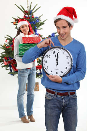 eagerly: Couple eagerly waiting for Christmas Day to open presents