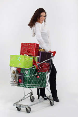 Woman with trolley full of Christmas presents photo