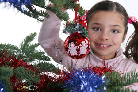 schoolgirl near decorated Christmas tree Stock Photo - 17304472