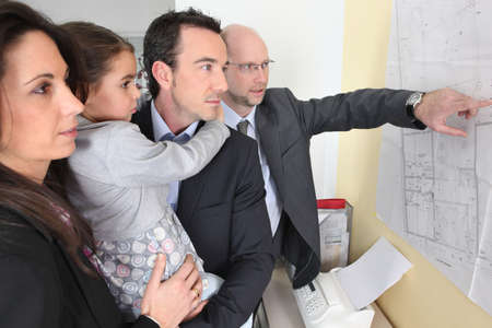 construction plans: couple and child in architects office Stock Photo