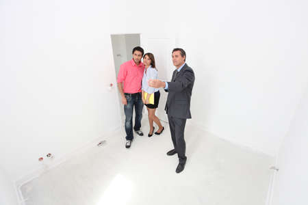 viewing: Couple being shown around a new property