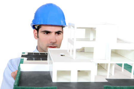 hardworker: Architect holding his building model