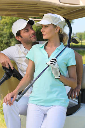 fair woman: Couple in golf buggy