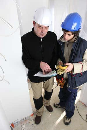 qualified worker: Electrician training apprentice Stock Photo