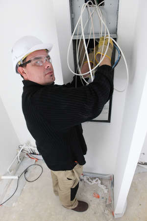 electrics: Electrician fitting house electrics