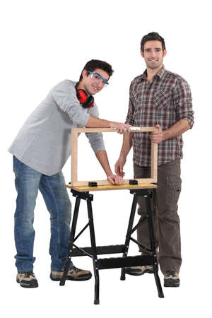 Father and son working on carpentry project photo