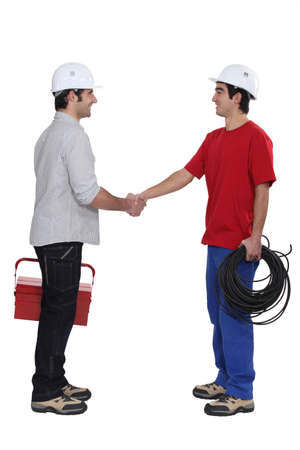 duo of electrician shaking hands photo