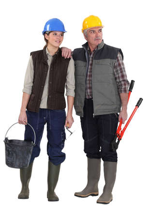 workwoman: Tradesman and his assistant staring sideways Stock Photo