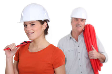 assembly line: Plumber and female apprentice Stock Photo