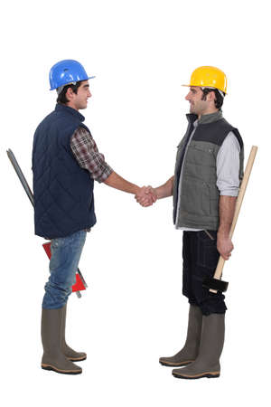 Two manual workers greeting each other photo