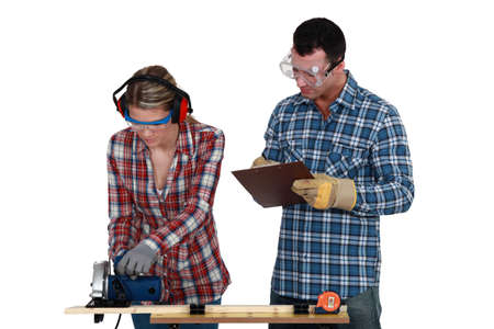 woodworking: craftswoman and craftsman working together in their workshop