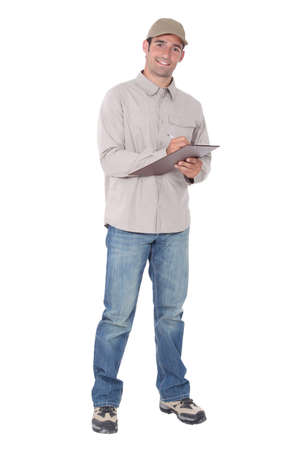 delivery driver: Delivery man with a clipboard Stock Photo