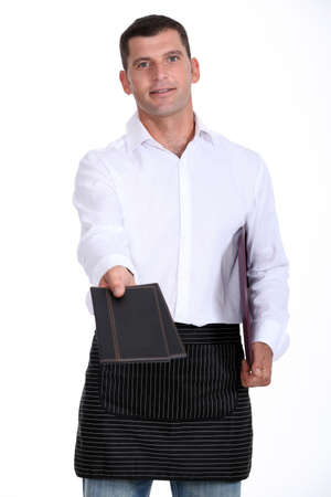 caf: Waiter holding out two menus Stock Photo